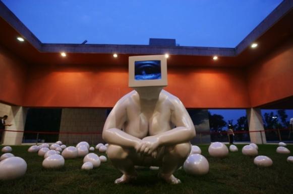 Gazing Back - procreating (outdoor), 2009. Polyurea, automotive paint, television recordings. (Lin Tianmiao).jpg